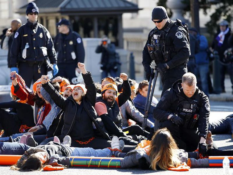 U.S. Capitol Police use bolt cutters to break chains locking together supporters of the Deferred Action for Childhood Arrivals (DACA) program, as the protesters cheer in support of DACA, on Capitol Hill in Washington.