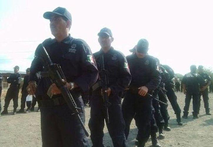 Los hechos ocurrieron cerca de la comunidad de La Estanzuela del municipio de Tepalcatepec, en los límites de Michoacán y Jalisco. En la imagen integrantes de la  Fuerza Rural. (Archivo/Agencias)