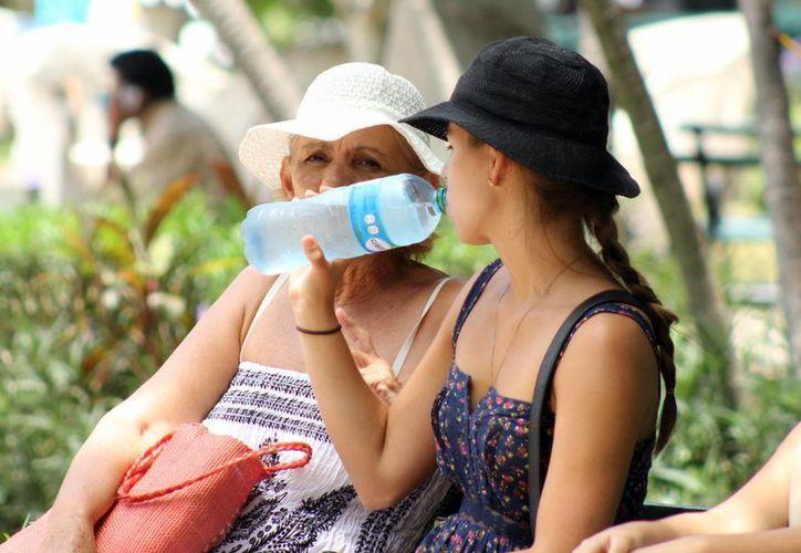Pese a que el Centro Hidrometeorológico Regional de Mérida pronostica un calor de incluso más de 40 grados para el fin de semana, también prevé que comience a llover. (SIPSE)