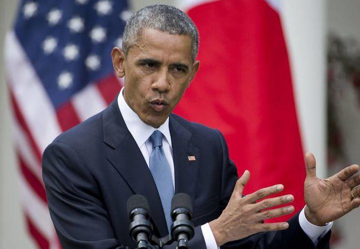 Obama aseguró que su gobierno está trabajando para aclarar los hechos alrededor de la muerte de Freddy Gay, de 25 años. (AP)