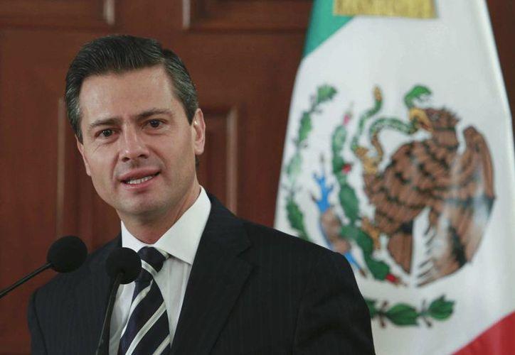 Peña Nieto declaró que con la Reforma Energética 'se termina un año distinguido por la modernización de los marcos legales'. (Notimex)