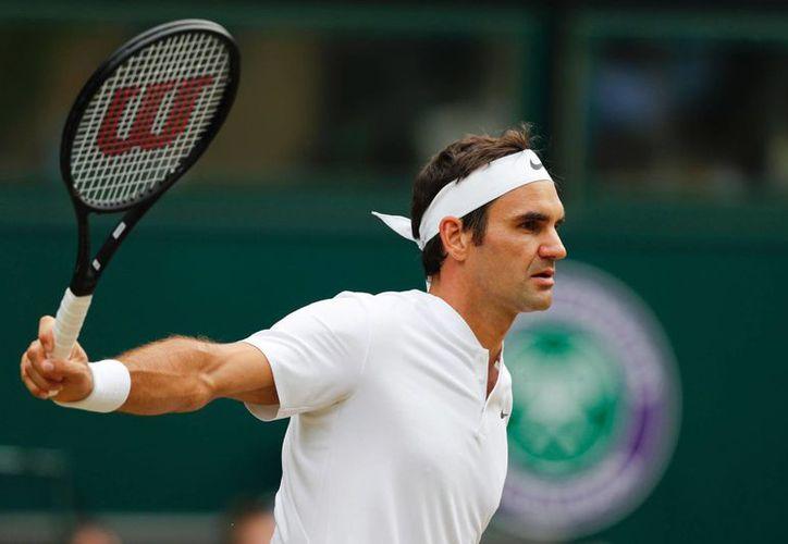 El suizo se convierte además en el rey indiscutible de Wimbledon. (El País)