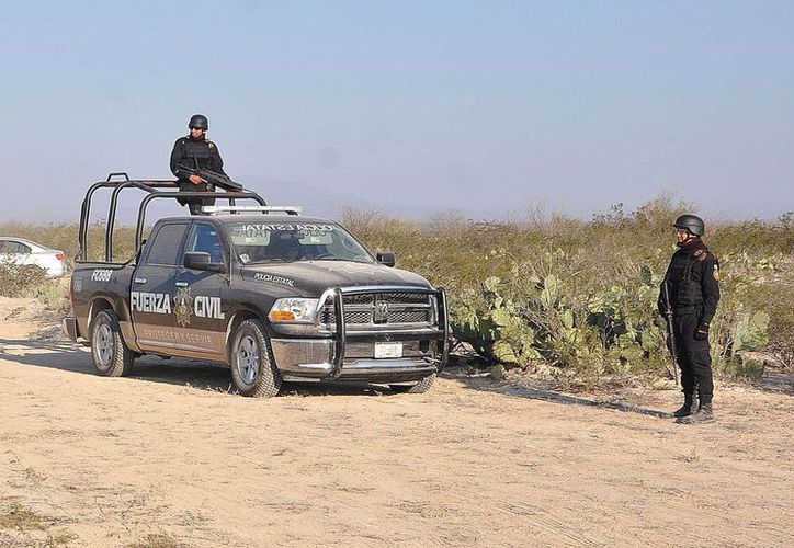 Se indicó que los trabajos de búsqueda por parte de personal forense, Protección Civil y policías continúan en el lugar. (Notimex)