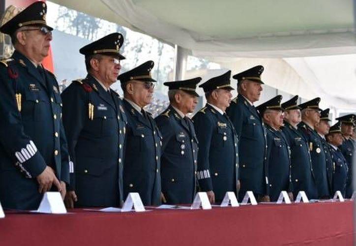 Ceremonia de la entrega de condecoraciones y reconocimientos a cinco generales de división, ahora retirados, esto en las en las instalaciones del Heroico Colegio Militar. (Twitter: S_Cienfuegos_Z)