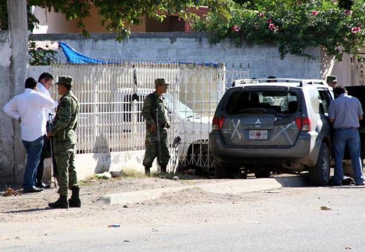 """Las fuerzas especiales arrestaron en un domicilio particular de Sinaloa a """"El Fantasma"""" y sus escoltas. (Agencias/Foto de archivo)"""