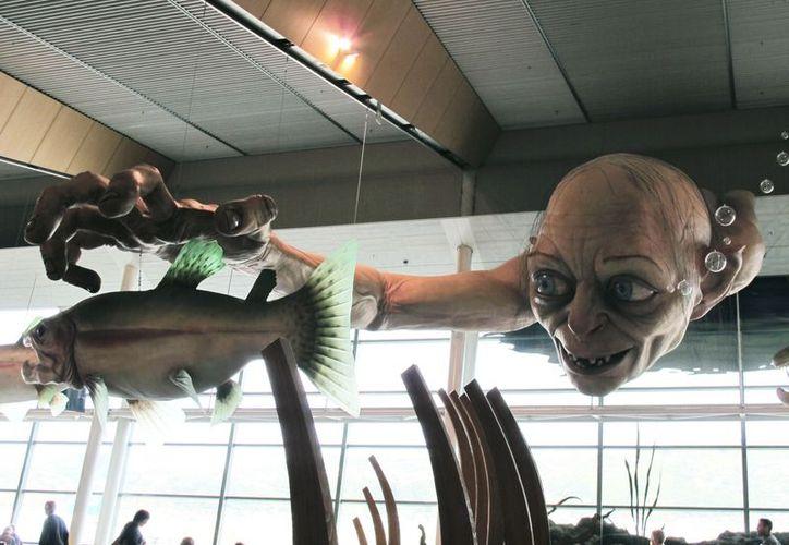 Por el estreno mundial de la trilogía del Hobbit, en el aeropuerto de Wellington instalaron una enorme estatua de Golum. (Agencias)
