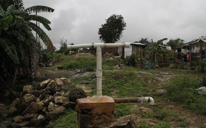 En las colonias irregulares el agua es obtenida de pozos. (Tomás Álvarez/SIPSE)