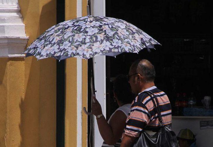 Los intensos rayos del sol 'acompañarán' a la mayor parte de los mexicanos, según el pronóstico del Servicio Meteorológico Nacional que prevé temperaturas mayores a 35 grados en 22 estado del país. (Milenio Novedades)