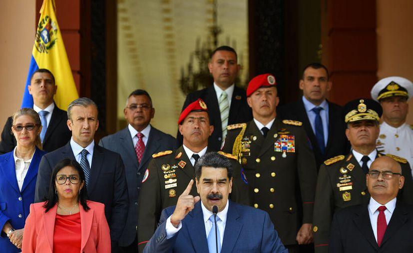 El presidente venezolano Nicolás Maduro habla en una conferencia de prensa en el Palacio Presidencial de Miraflores en Caracas, Venezuela. (AP Foto/Matias Delacroix)