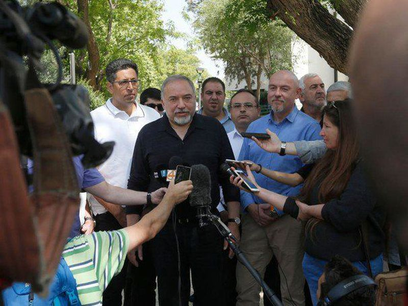 Israeli Defense Minister Avigdor Lieberman (C) talks to reporters during a visit to the Israeli settlement of Katzrin in the Golan Heights. (AP)