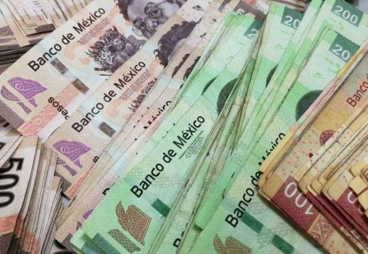 De eliminar comisiones bancarias habría alza en tasas y despidos. (Foto: Contexto/Internet)