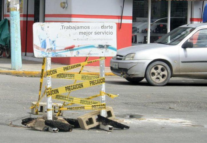 Los trabajos de rescate de calles y avenidas de la capital continuarán hasta que mejoren las condiciones climáticas. (Harold Alcocer/SIPSE)
