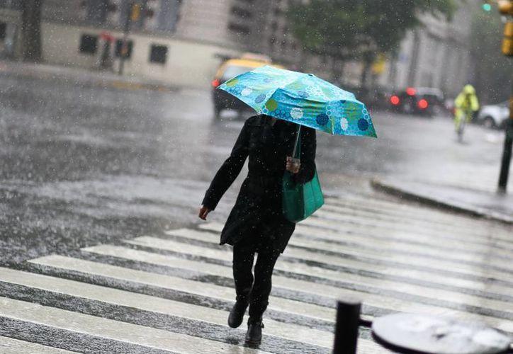 El temporal de lluvia y viento que afectó a la región entre el jueves y el viernes. (Archivo/EFE)