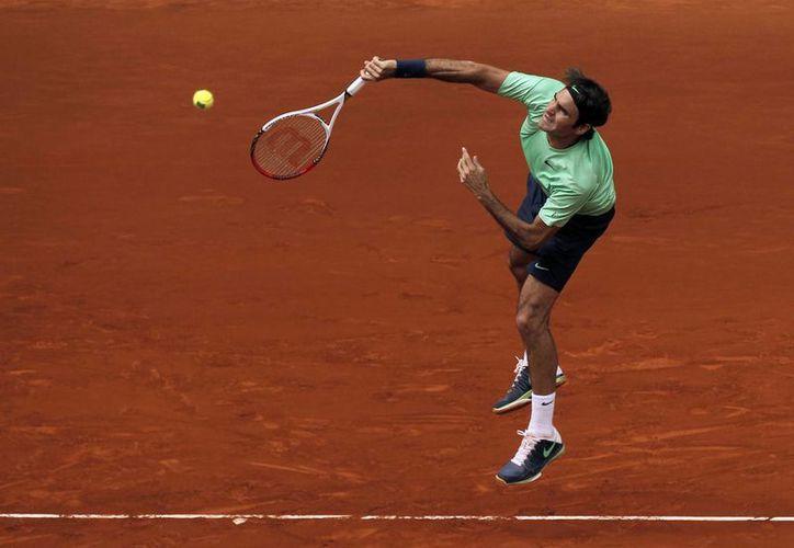 Federer se medirá ahora al ganador del duelo entre el japonés Kei Nishikori y el serbio Viktor Troicki. (Agencias)
