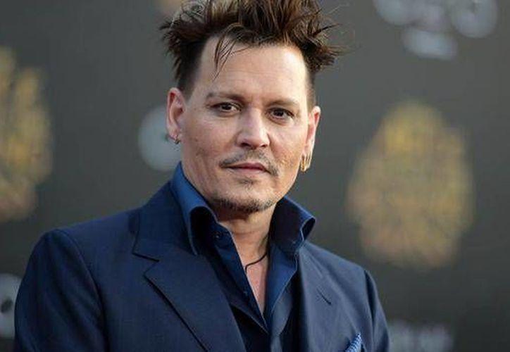 Ha trascendido que el actor Johnny Depp presenta problemas financieros debido a sus excesivos gastos. (Archivo/ AP)
