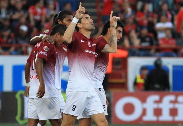 Hector Mancilla del Morelia en festejo durante el juego de la jornada 15 del torneo Clausura 2013 de la Liga MX en el Estadio Caliente. (Agencias)