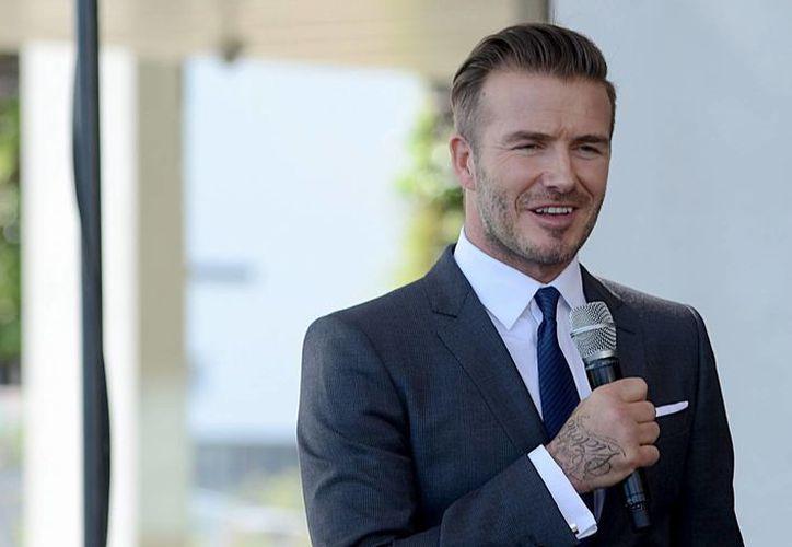 Beckham construirá un estadio de fútbol en Miami junto al campo de los Marlins. En la foto, el exfutbolista británico durante una conferencia. (EFE)