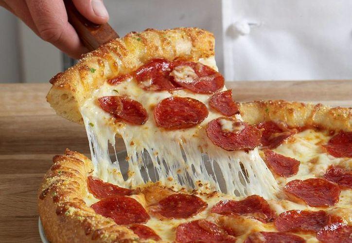 El desafortunado estudiante le tocó pagar de más por una pizza de Domino´s. (Archivo/Agencias)