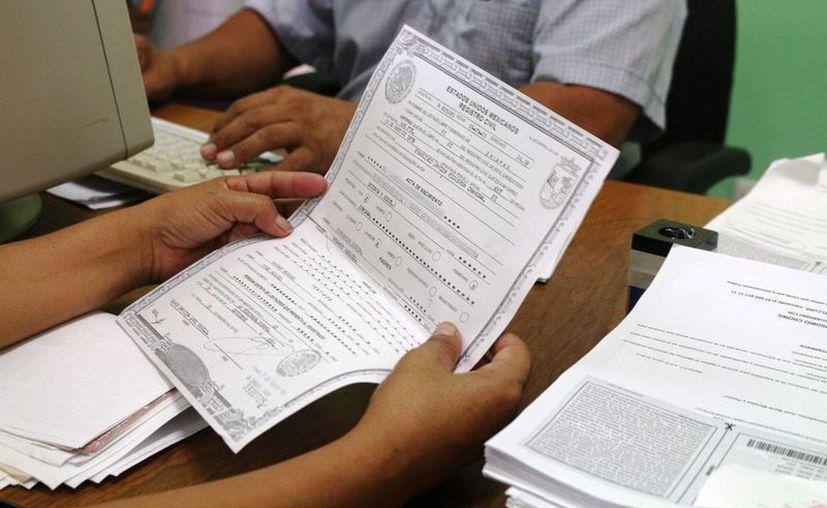 El nuevo servicio para expedir actas de nacimiento foráneas se podrá realizar en las oficialías del Registro Civil ubicadas en Umán, Valladolid e Izamal. (Archivo/Milenio Novedades)