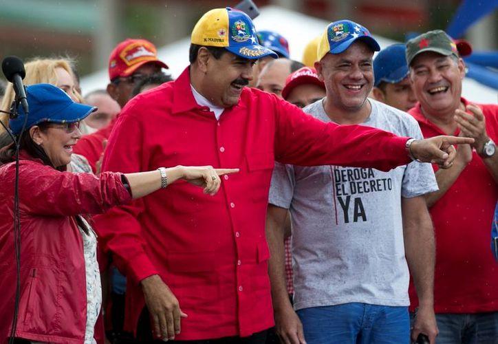 Maduro admite que tiene diferencias políticas con el nuevo presidente de Estados Unidos, Donald Trump. (AP/Ariana Cubillos)