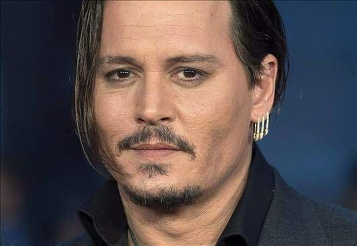 Johnny Depp fue el actor menos rentable para Hollywood en 2015, según la lista publicada hoy por la revista Forbes. (EFE)