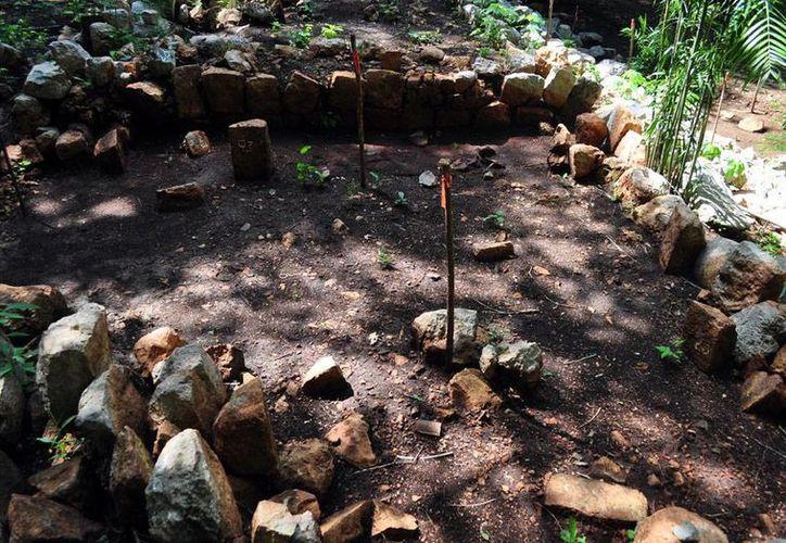 Los más recientes hallazgos de vestigios arqueológicos en el oriente de Mérida han dado luz a los expertos sobre detalles de los sepulcros de infantes mayas. La fotografía es e contexto. (Milenio Novedades)