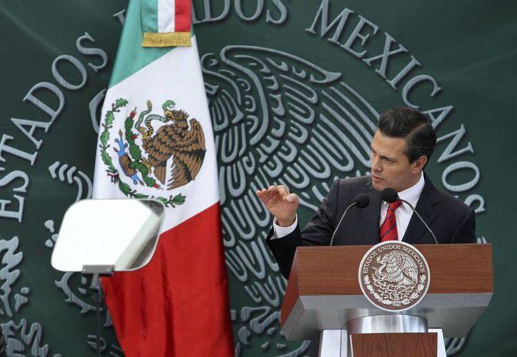 El presidente Peña Nieto exhortó al Congreso a aprobar a la brevedad la legislación secundaria de la reforma político electoral. (Notimex)