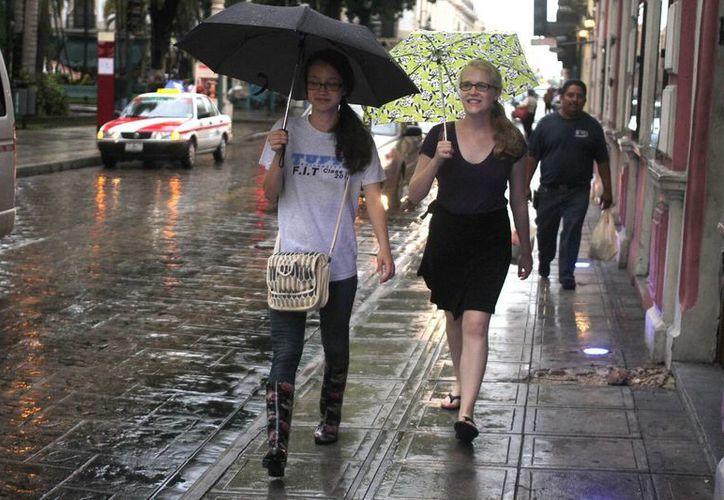 En la Península de Yucatán se pronostica cielo medio nublado, baja probabilidad de lluvias con intervalos de chubascos en Campeche, Yucatán y Quintana Roo.(Archivo/Notimex)