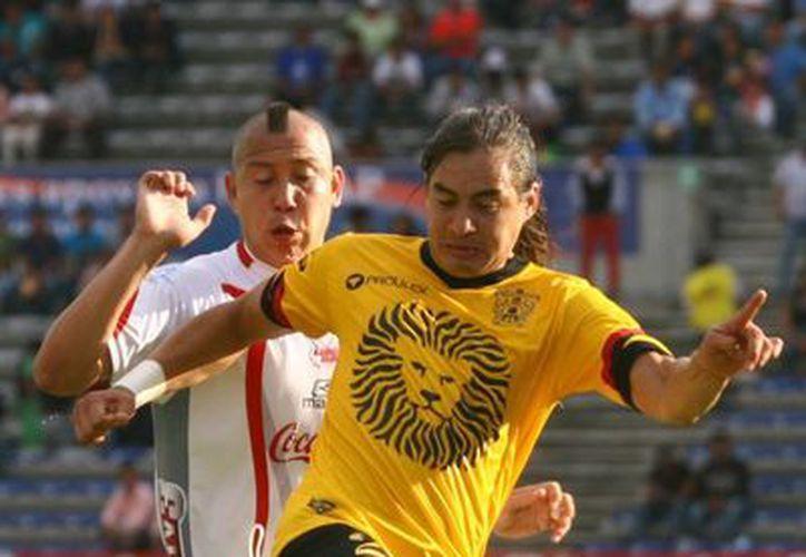El líder, Leones Negros se enfrenta a un peligroso Neza que busca regresar a Primera División. (Archivo Notimex)