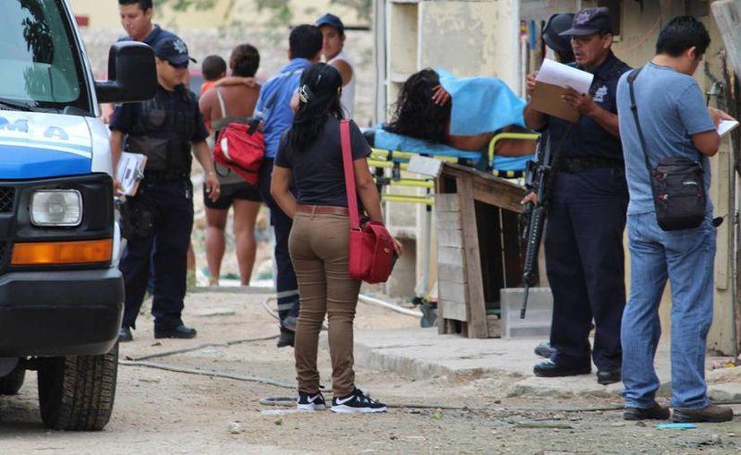 Las mujeres fueron halladas desnudas y con heridas, al parecer provocadas por una hacha pequeña. (Foto: Redacción)