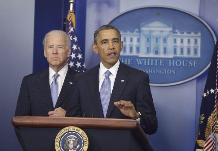 El presidente Barack Obama y el vicepresidente Joe Biden durante una rueda de prensa sobre el 'precipicio fiscal', en la Casa Blanca, en Washington. (Agencias)