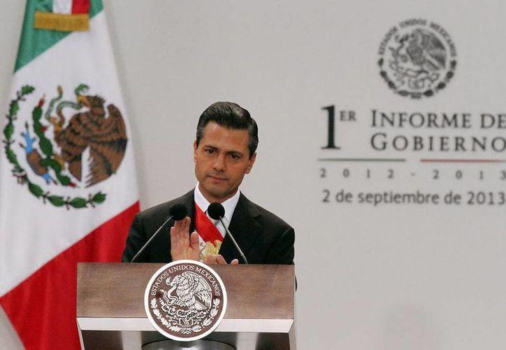 El presidente Enrique Peña Nieto leyó un extracto de su I Informe. (NTX)