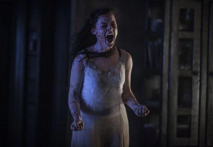 """La actriz Jane Levy  en una escena de la nueva versión de """"Evil Dead"""". (EFE/Kirsty Griffin/TriStar Pictures)"""