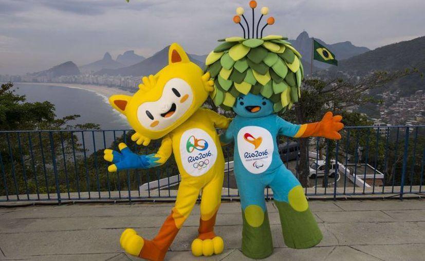 En imagen, las máscotas oficiales de Río de Janeiro 2016. Los Juegos Olímpicos,  que se disputarán del 5 al 21 de agosto, son los primeros en realizarse en Sudamérica. (Imágenes de AP)
