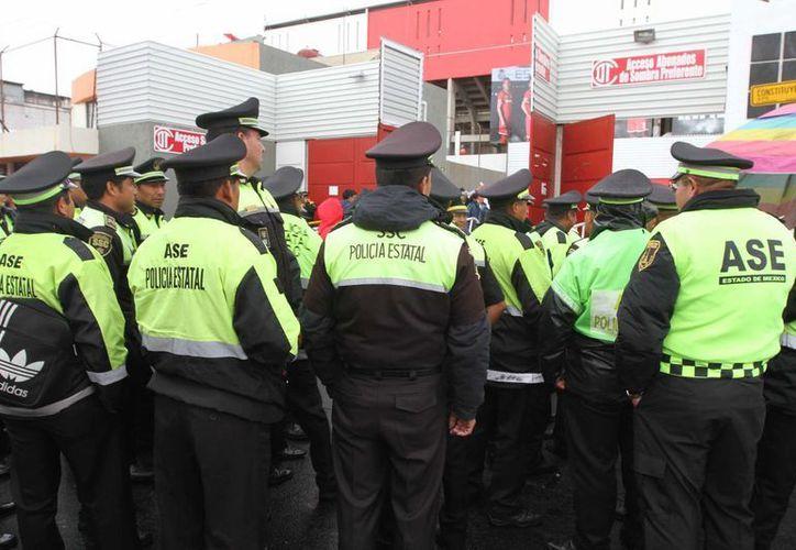 Los policías de los tres niveles de gobierno cursarán un programa de profesionalización. (Archivo/Notimex)
