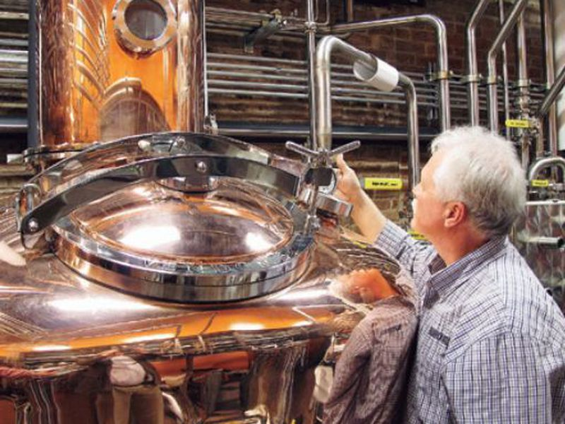 Charlie Downs, the artisanal craft distiller at a new Heaven Hill Distilleries, Louisville, Ky., checks gauges on a still that will produce small batches of whiskey. (AP)