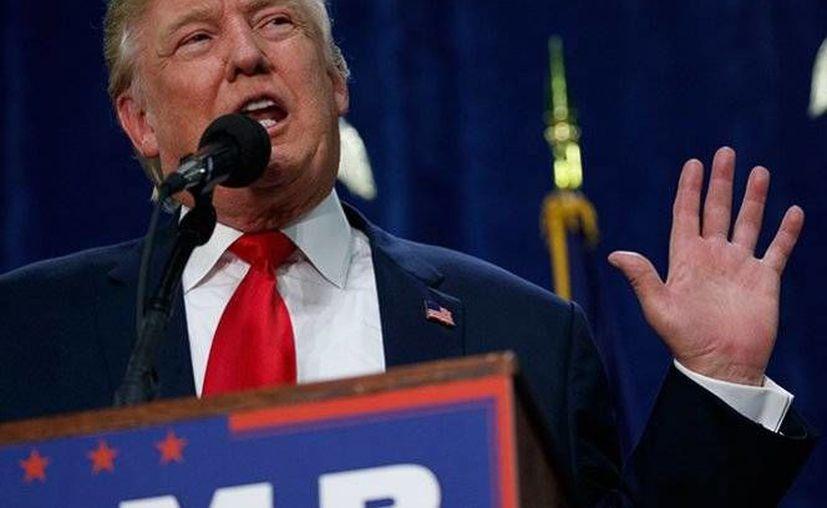 Donald Trump, aspirante republicano a la Casa Blanca, fue demandado por fraude. Trump aceptó que era portavoz de un proyecto sobre propiedades. (Foto: AP)