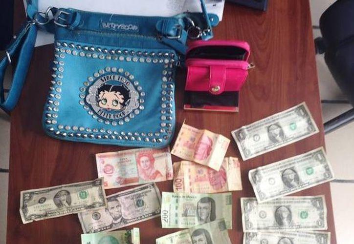 Una mujer fue detenida cuando intentó ingresar a la cárcel con droga y 8 mil pesos en efectivo, de forma clandestina. (Cortesía/SIPSE)