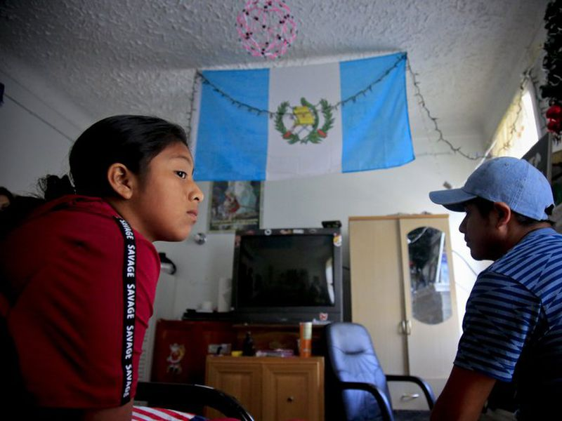 Manuela Adriana, 11, left, sit with her father Manuel Marcelino Tzah inside their apartment hours after her release from immigrant detention, Wednesday July 18, 2018, in Brooklyn borough of New York. (AP)