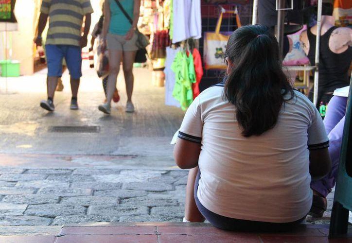 Los problemas depresivos asociados con el peso se presentan en la escuela. (Consuelo Javier/SIPSE)