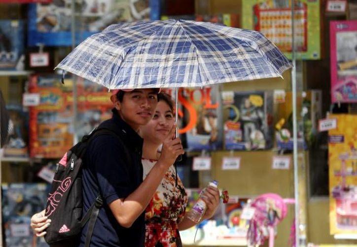 Este fin de semana la temperatura en Yucatán puede llegar hasta los 35°C, enmedio de lluvias de ligeras a moderadas. (Milenio)