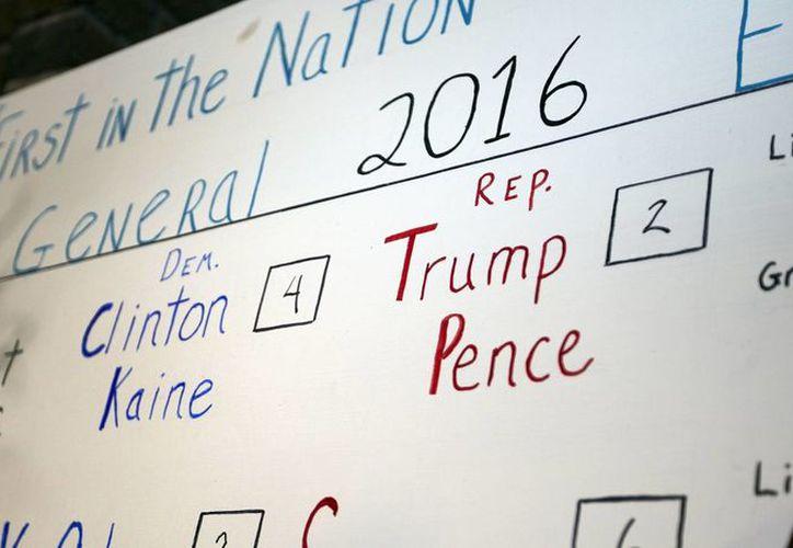 Falta contabilizar los votos de los estados más grandes de EU, que podrían o no dar el triunfo a Hillary Clinton. (AP/Jim Cole)