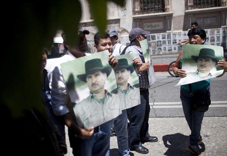 Seguidores del expresidente guatemalteco Alfonso Portillo, extraditado a Estados Unidos, se manifiestan en la capital guatemalteca. (EFE)