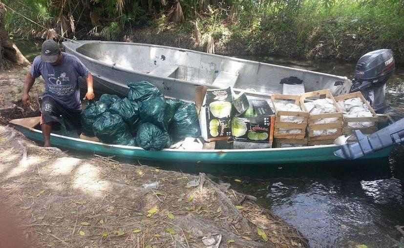 El tráfico ilegal de mercancía lleva varios años en la ribera del río Hondo. (Edgardo Rodríguez/SIPSE)