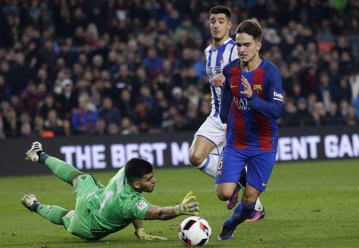 Denis Suárez (foto) anotó el primer y el quinto gol del Barza, que goleó a Real Sociedad para avanzar entre los semifinalistas de Copa del Rey, instancia en la que ya estaban Atlético de Madrid, Celta de Vigo y Alavés. (AP)