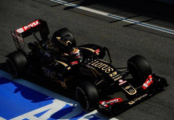 Los latinos tuvieron un buen desempeño este jueves en las pruebas del Gran Premio de España. El venezolano Pastor Maldonado (foto) registró el mejor tiempo; 'Checo' Pérez obtuvo el cuarto entre los mejores registros. (AP)