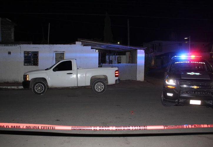 Policías encontraron un total de siete casquillos percutidos, en los domicilios y una camioneta. (Foto: Redacción/SIPSE)