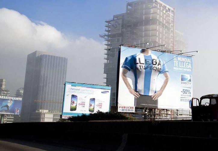 Argentina trata de acomodarse a los horarios en que juegue su selección en la fiesta del futbol en Brasil. (AP)