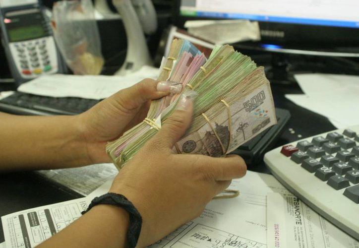 Deben reportarse operaciones superiores a los 100 mil pesos. (Israel Leal/SIPSE)