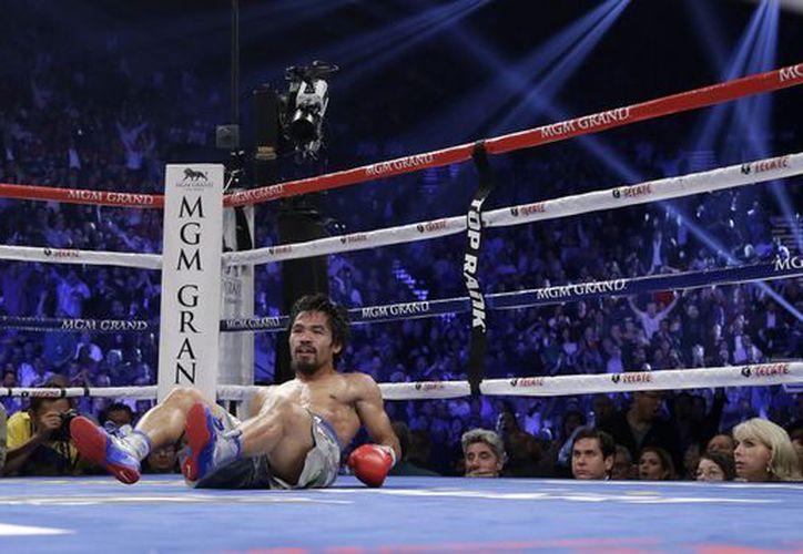 Familiares y seguidores le han pedido a Pacquiao que se retire del boxeo. (Foto: Agencias)
